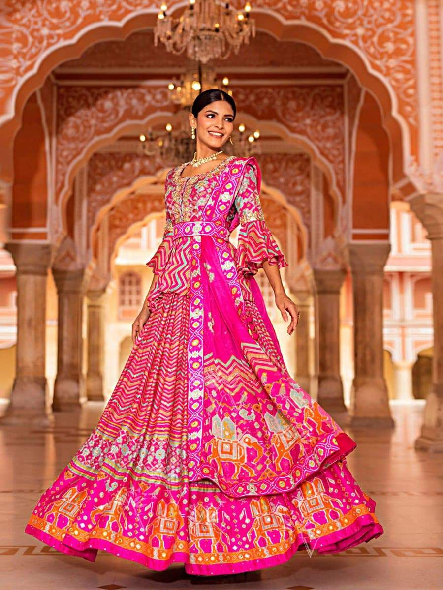 Pink Leheriya Patola Silk Lehenga with Modish Peplum Top