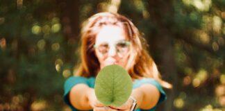 Lady holding a leaf, showing sustainability